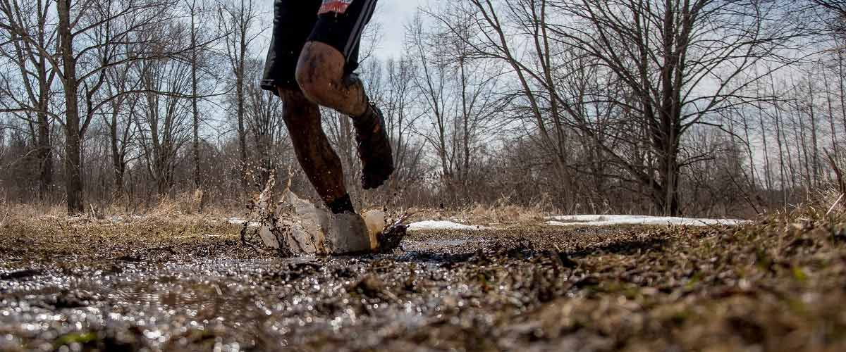 Running on a muddy trail
