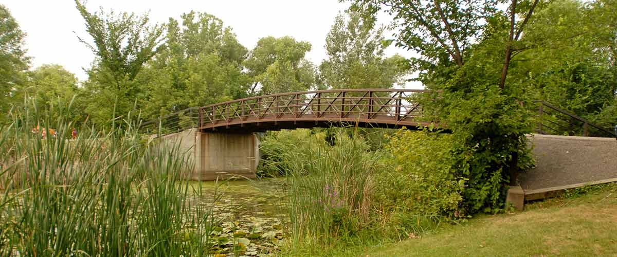A bridge over a stream in french regional park.