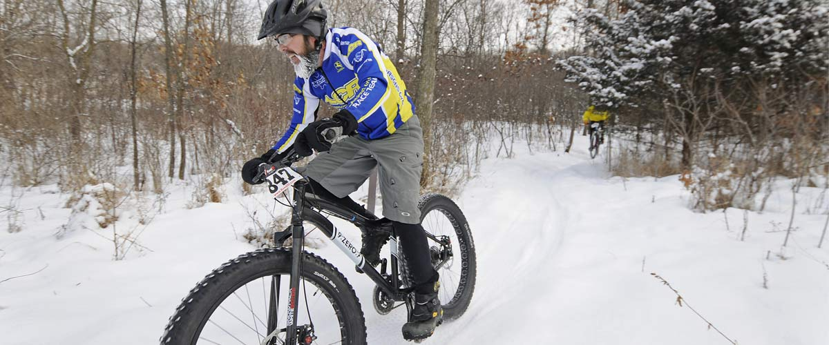 a mountain biker on a snowy trail
