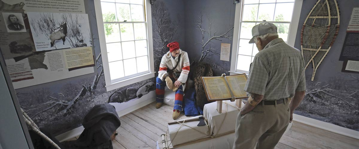 people view interpretive displays inside the Pierre Bottineau house.