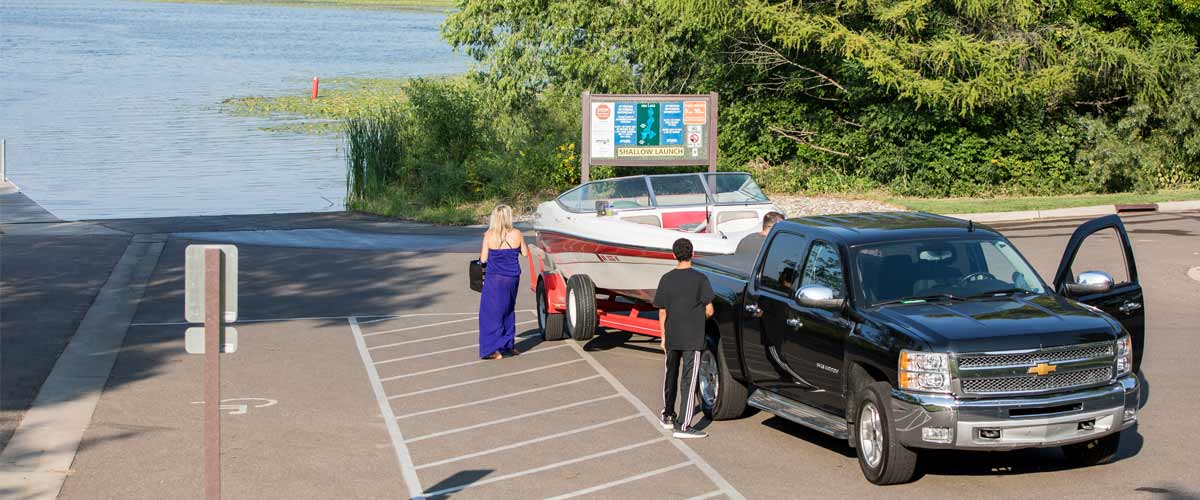 a truck pulled up to a boat launch