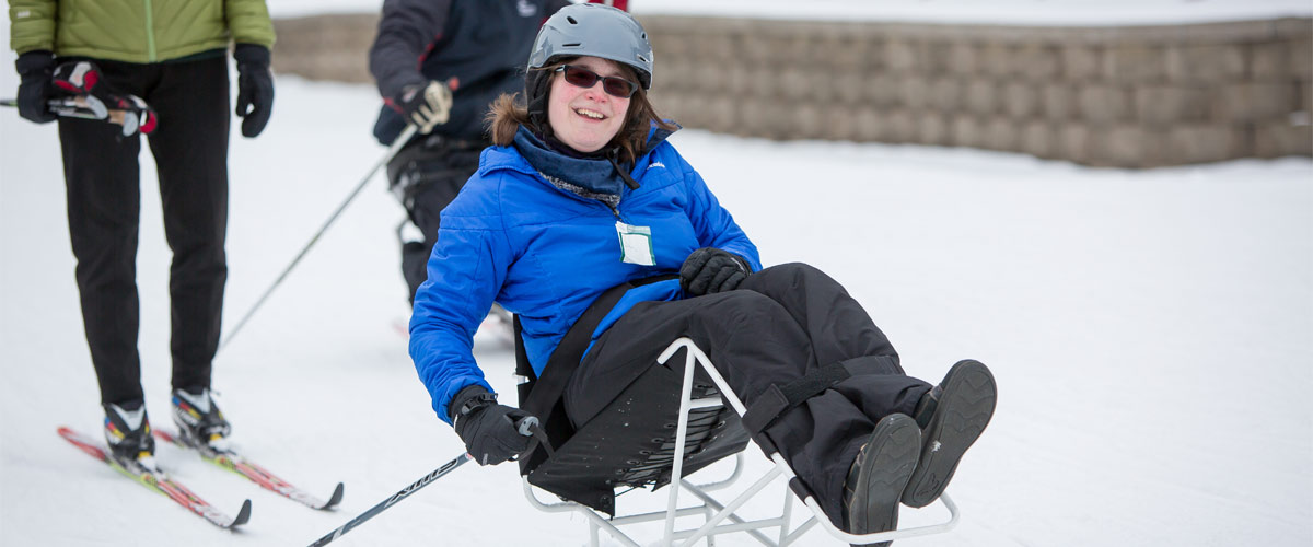 a woman in an adapted sit-ski