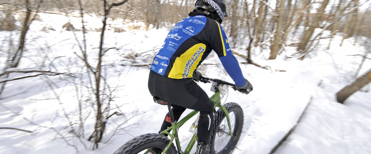 a mountain biker on a snowy trail.