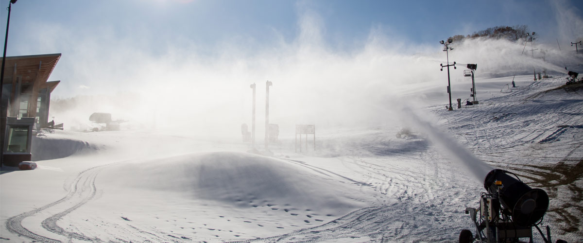 making snow on a downhill ski area.