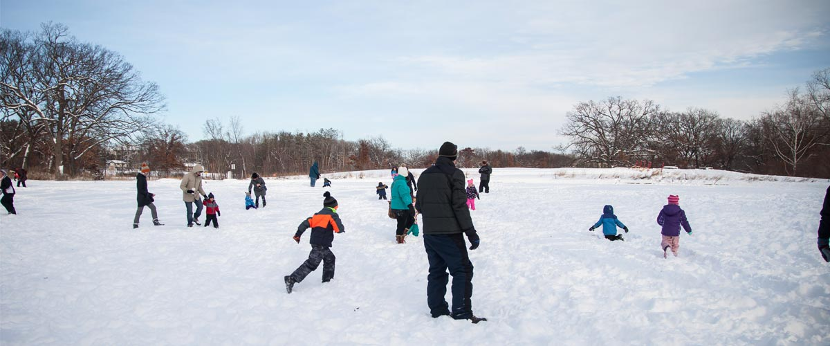 people playing on a frozen lake