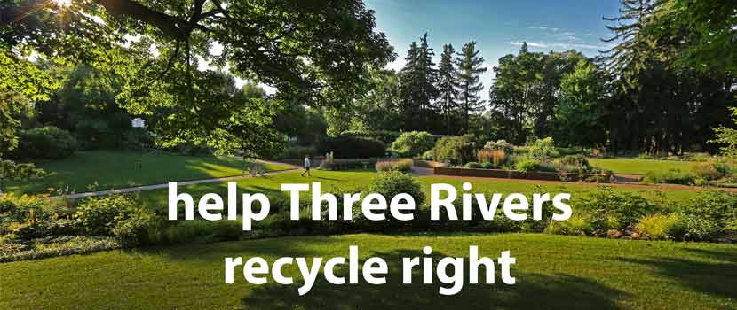 "A grassy garden area with trees and blue sky. White text at the bottom of the photo says ""help Three RIvers Recycle Right."""