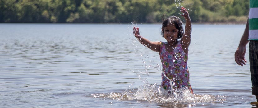 a girl playing in the water.