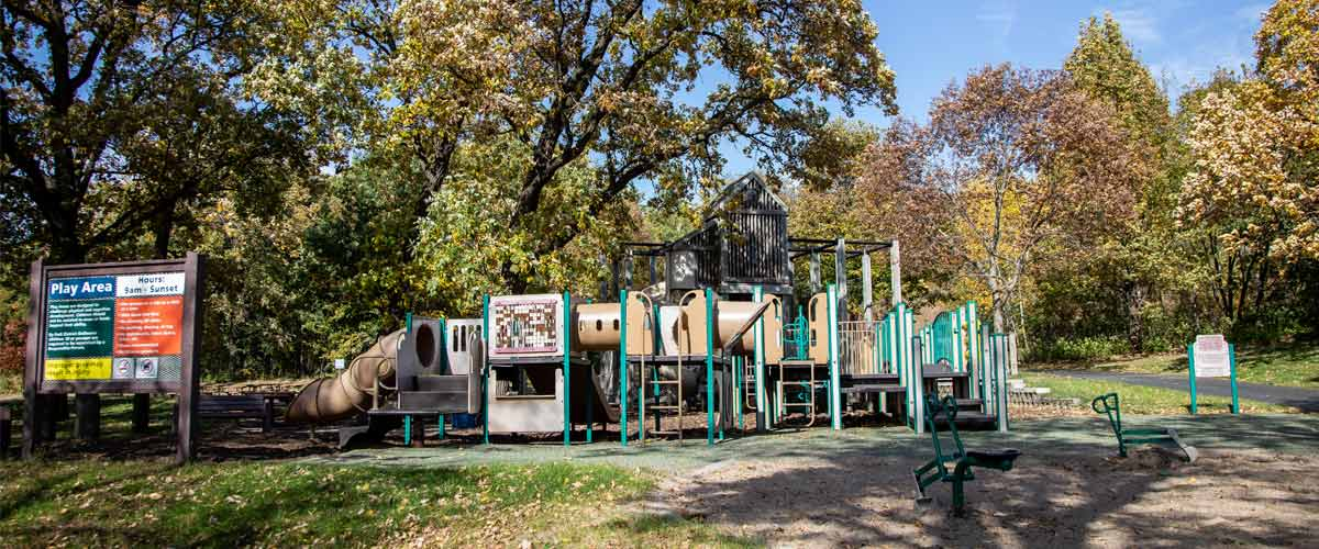 A small tan and green play area in the fall.