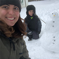 jenifer garcia and her nephew building a snowman