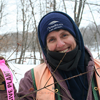 Missy Anderson in winter at an invasive species removal event