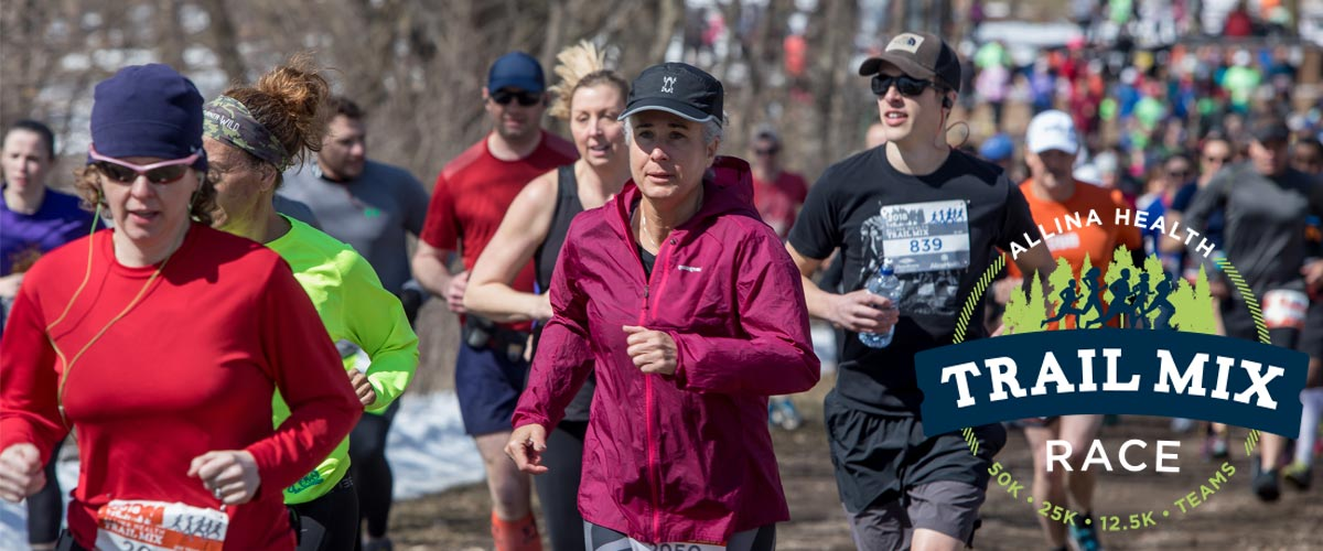 Runners race down a wooded trail in the Trail Mix Race.