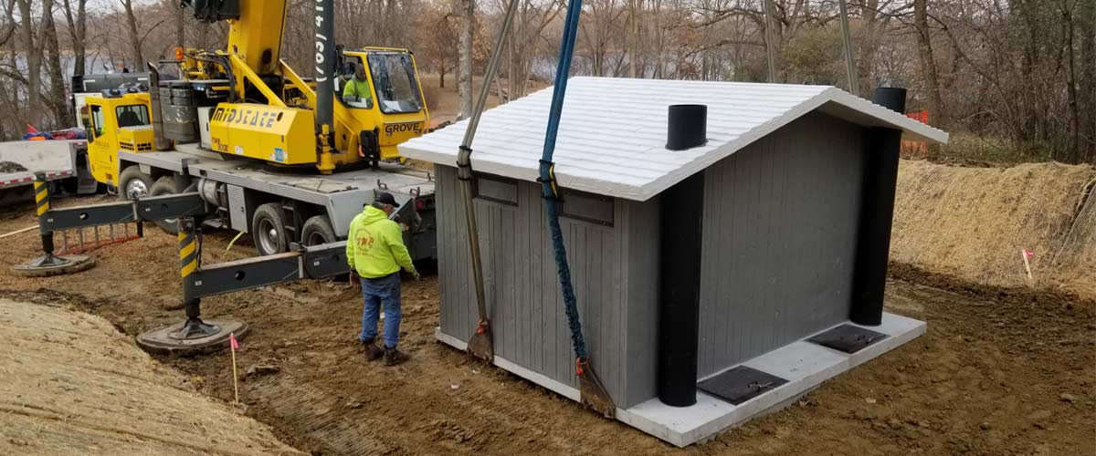 Crews work to construct a new small building.