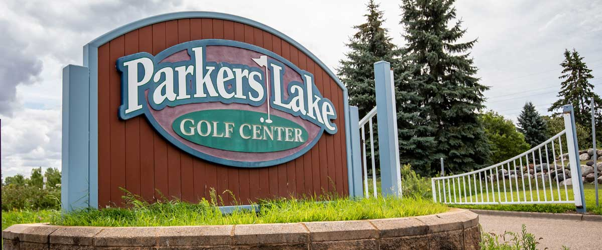 A sign at a golf course entrance reads Parkers Lake Golf Center.