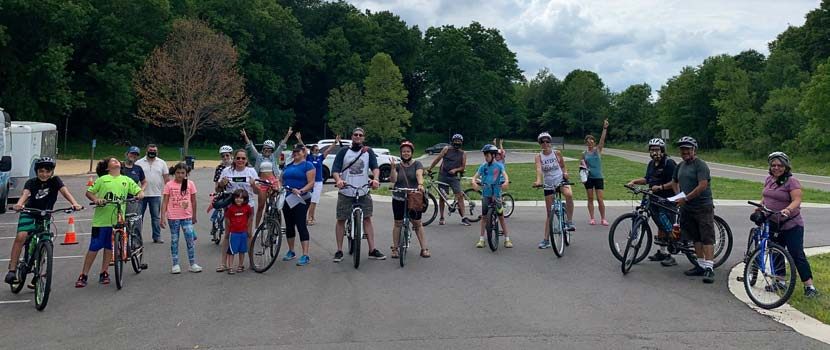 The Outdoor Latino MN group poses for a picture at a Three Rivers biking event.