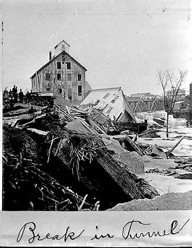 black and white photo of collapse of sawmills on the falls