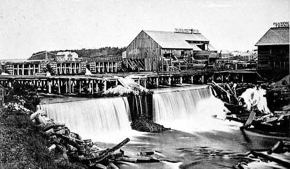 black and white photo of sawmills at St. Anthony Falls in 1860