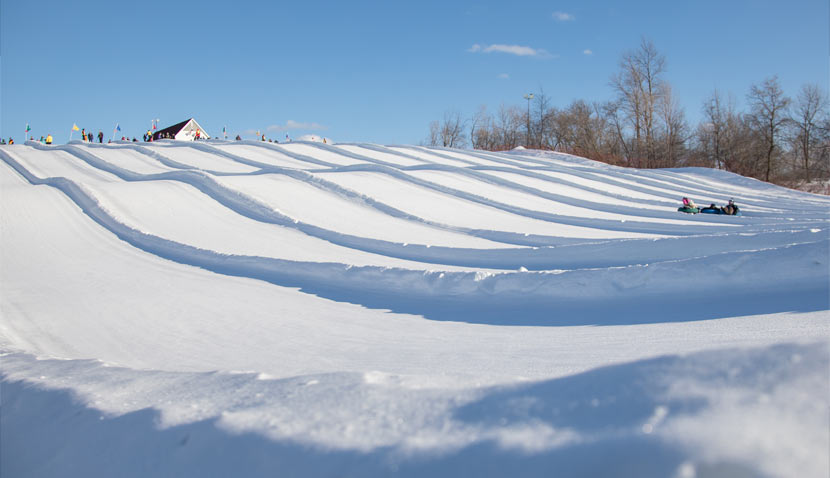 snow divided lanes of the tubing hill