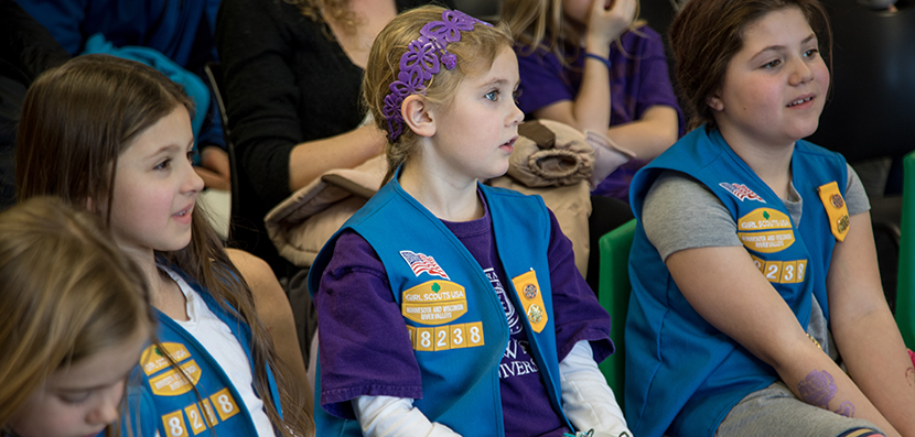 girl scouts listening to speaker