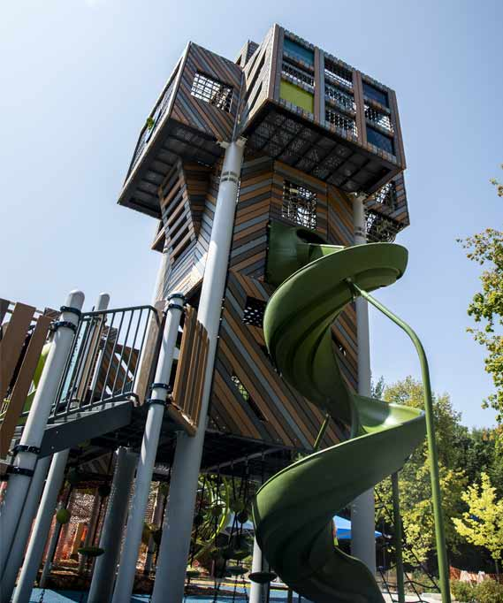 play area tower with a twisting slide.