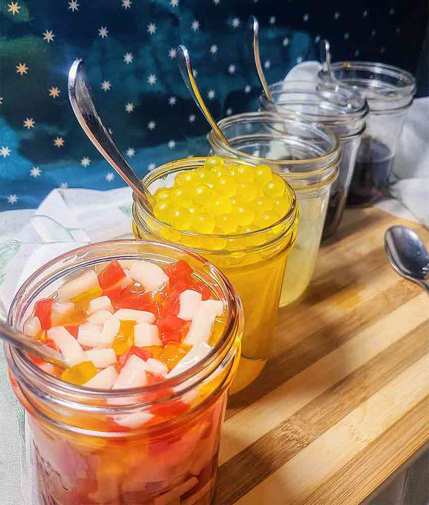 tri color jellies and mango pearls in mason jars