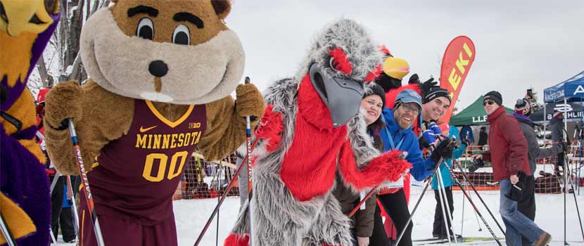 goldy gopher and other mascots lined up to race.